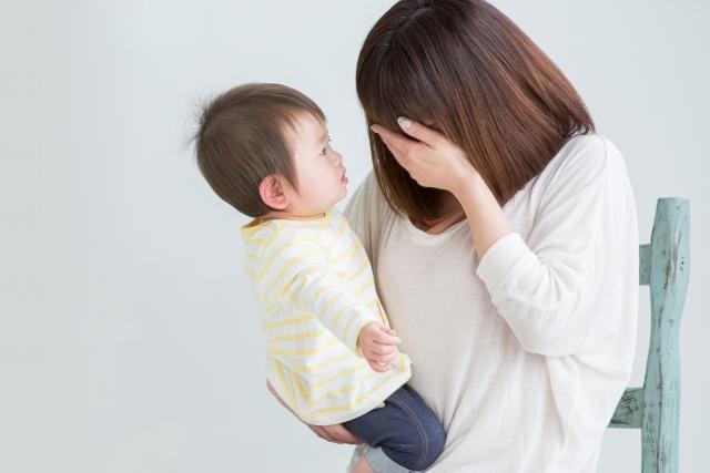 産後から身体の不調に悩む女性